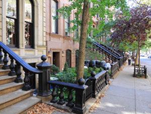 Brownstones along New York City sidewalk