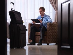 Traveling executive works on tablet