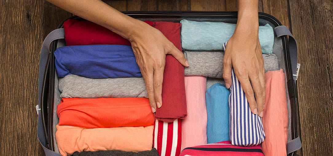 Pack more into your suitcase by rolling clothing.