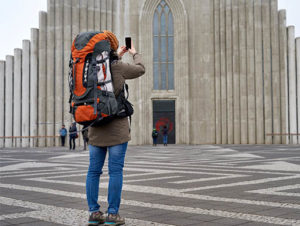 Tourist takes photo of Hallgrimskirkja cathedral in Reykjavik