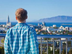 Man viewing Reykjavik city and coastline in Iceland