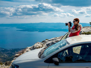 Passenger and driver can enjoy the breathtaking mountain views while driving across Utah