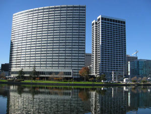 """""""The curved exterior of the Kaiser Center building is reflected off the water in downtown Oakland, California"""