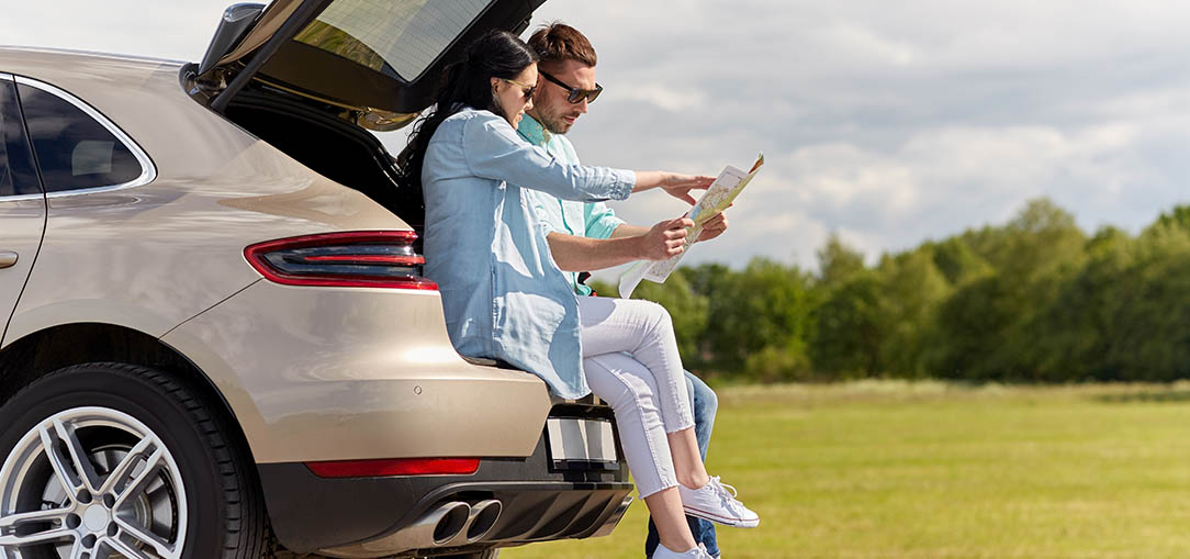 Couple stop to look at map while on a road trip