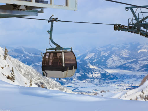 Incredible view of a gondola and the glacial slopes of Zell am See-Kaprun, Austria on a beautiful sunny day