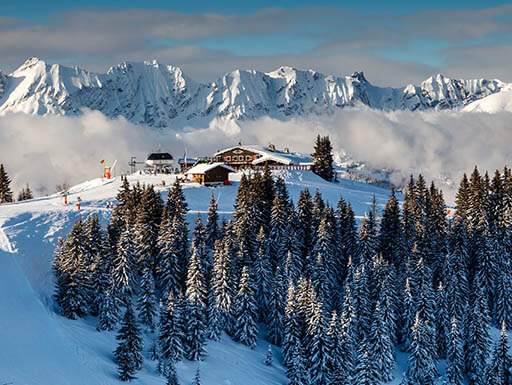 A panoramic view of the mountain ranges near Megeve, France's rustic ski resort on a beautiful winter's day