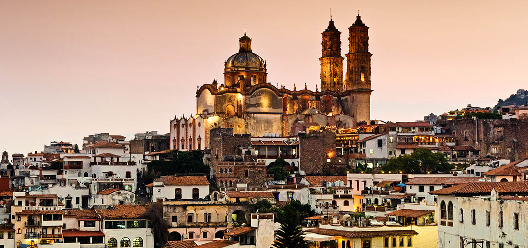 Baroque Church and historical architecture in Taxco, Mexico at dusk