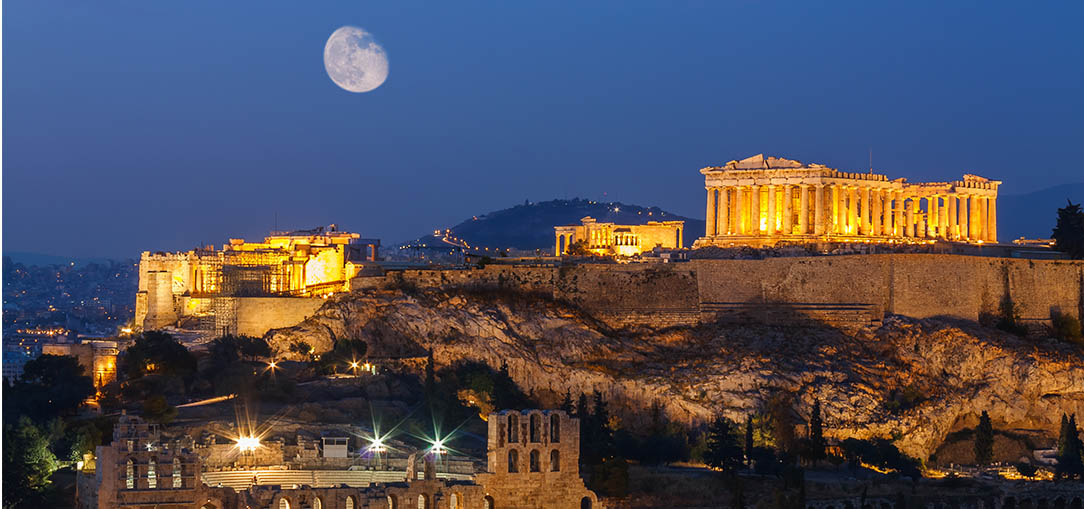 Blue hour view of Parthenon and Herodium in Acropolis Hill in Athens