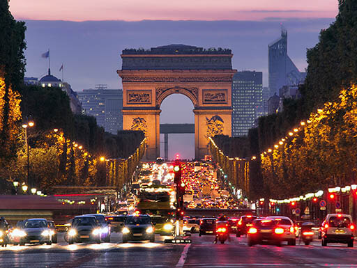 Traffic passing to and from the Arc de Triomphe in the evening light