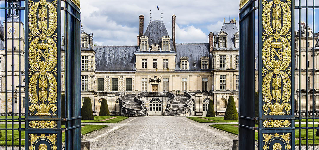 The entrance to the former royal castle of Fontainebleau