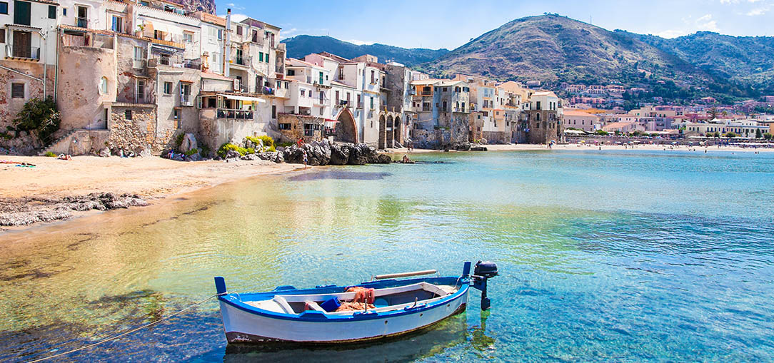 Wooden boat floating off the coast of Sicily
