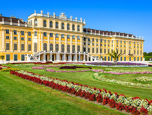 A sunny view of the exquisite Schonbrunn Palace and gardens in Vienna, Austria