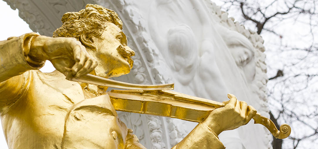 A close-up view of the gilded bronze statue of the famous Austrian composer: Johann Straus II, in Stadtpark, Vienna