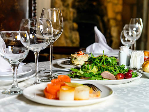 Plates of fresh food with wine glasses on a table in a restaurant in St. Augustine, Florida