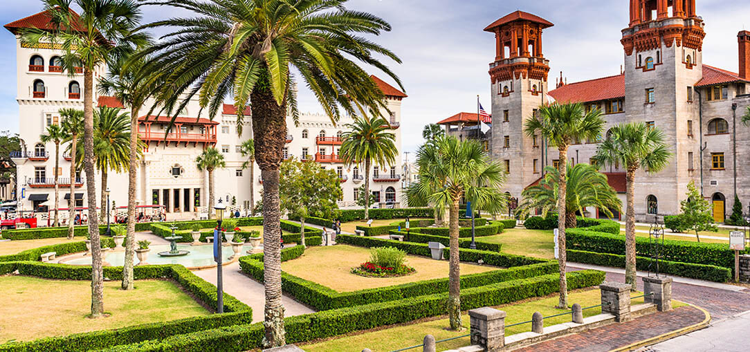 Tall palm trees in front of Spanish colonial buildings in St. Augustine, Florida
