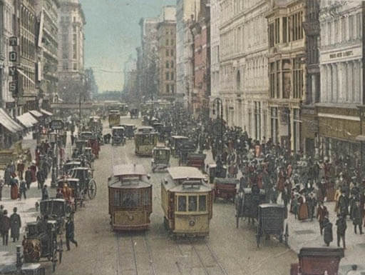 Circa 1907 image of a postcard of New York City streetcar with people on the street