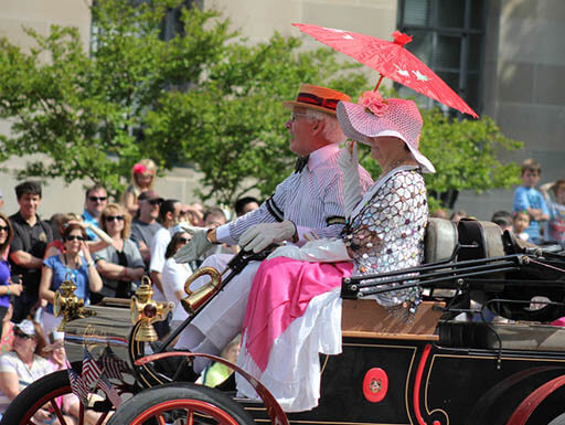 Two people on a float in the National Cherry Blossom Festival Parade in 2012