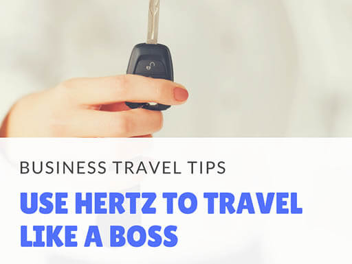 A female business traveler's hand is shown clearly in the foreground holding the key to a vehicle, while the back of the image is blurred, with the words Business Travel Tips, Use Hertz to Travel Like a Boss, written on top