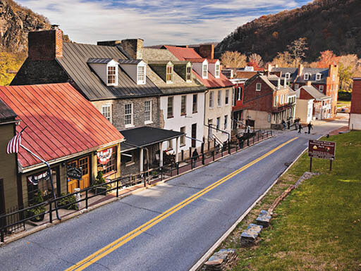 View of historic buildings and shops next to a paved road on High Street in Harpers Ferry, West Virginia