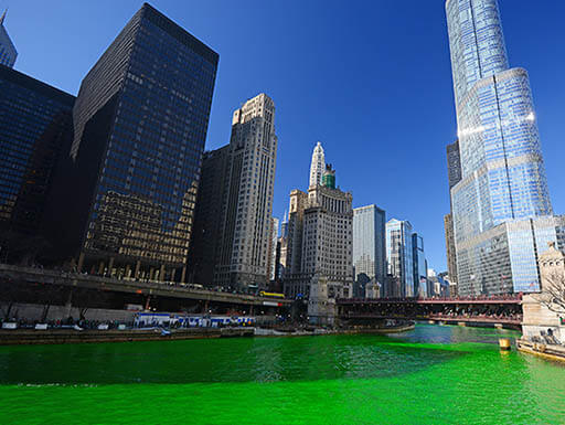 The Chicago River in bright green is pictured in front of the skyline of downtown Chicago during St. Patrick's Day Celebrations.