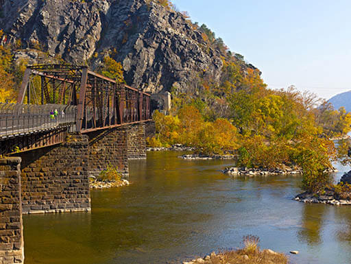 Appalachian trail crossing over the Shenandoah River on a bright fall day in scenic Harpers Ferry, West Virginia