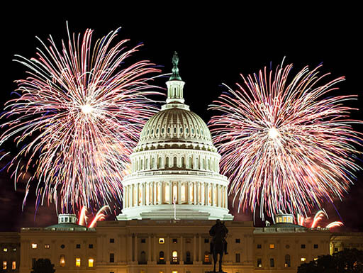 Fireworks are seen behind the United States Capitol Building at night in Washington, D.C.