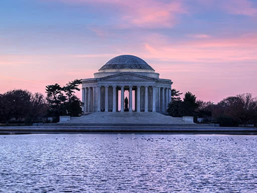 The Potomac River is pictured in front of the Jefferson Memorial during a spring sunrise.