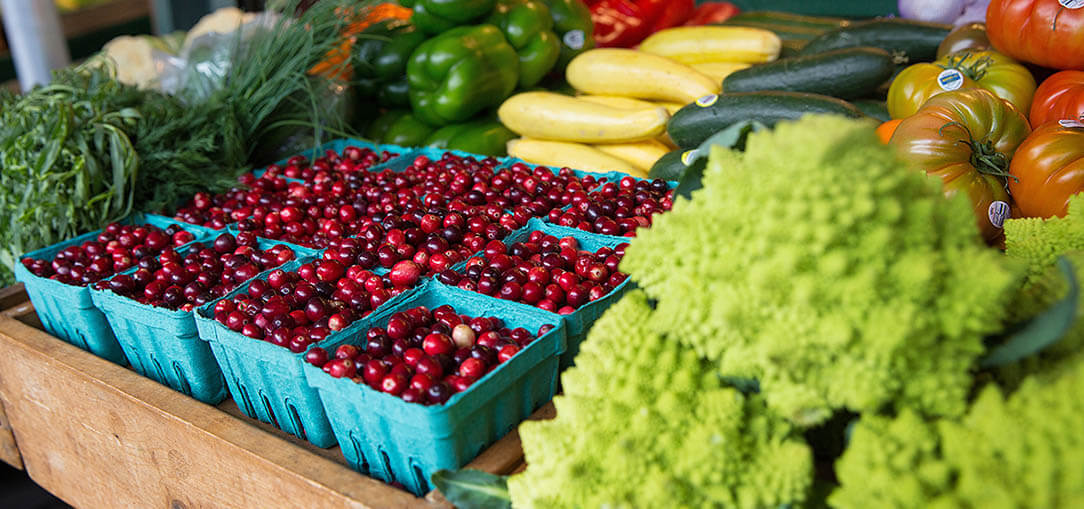 Fresh fruit and vegetables at a farmer's market stand on a beautiful morning on the West Coast.