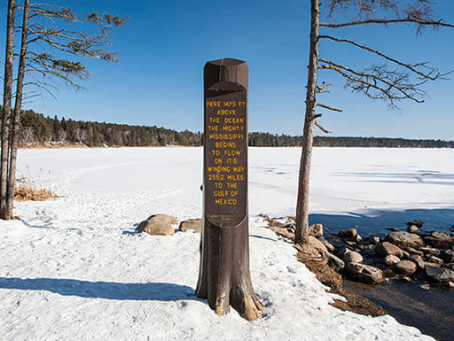 The start of Lake Itasca in Northern Minnesota on a sunny day with snow on the ground