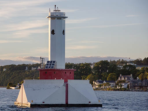 Mackinac Island in northern Michigan and a white, floating lighthouse on Lake Huron