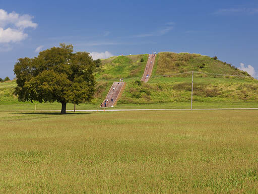 Grass-covered Cahokia Pyramid near St. Louis along the Great River Route on a sunny day