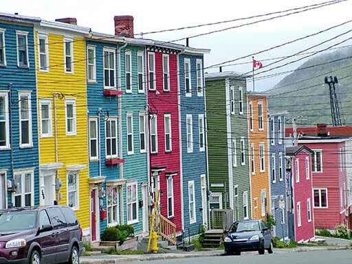 "Vibrantly colored ""Jelly Bean"" row houses line the steep slopes in St. John's, Newfoundland"