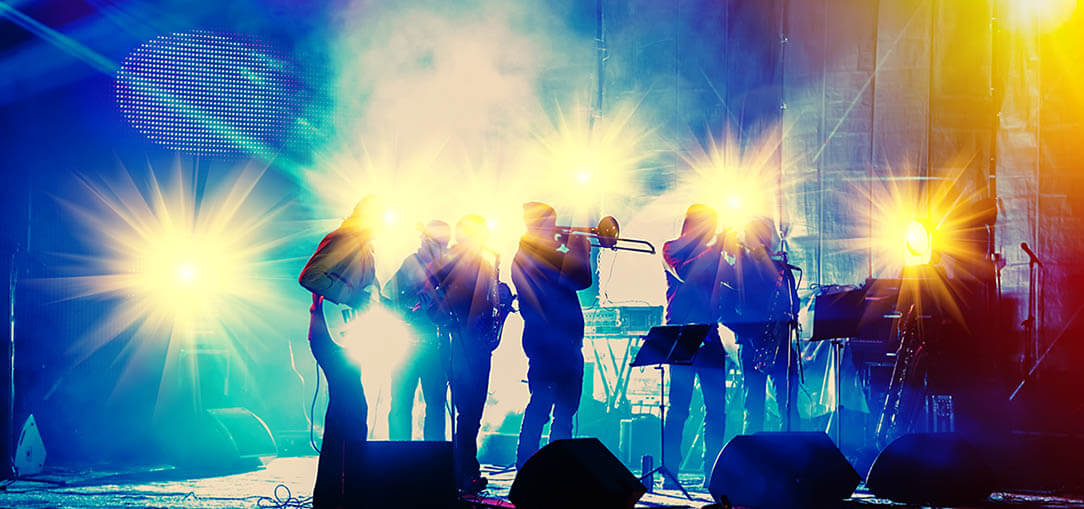 musicians on concert stage lit by blue and orange lights in Memphis, Tennessee