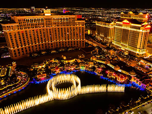 An aerial view of the Bellagio's fountain water show at night in Las Vegas