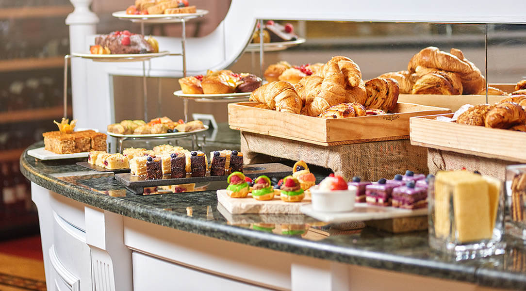 Pretty hotel breakfast buffet consisting of freshly made pastries