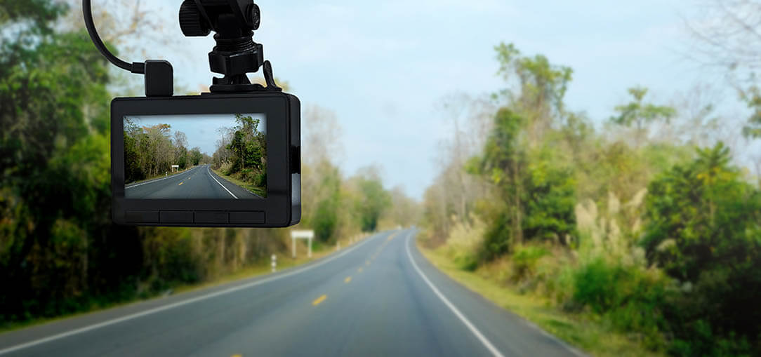 A front dash cam connects to your windsheild or rearview mirror to record your drive