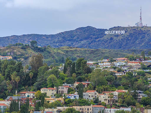 Aerial view of the famous Hollywood sign in the mountains behind Los Angeles, California on a cloudy day