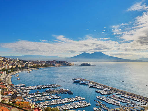 Aerial scenic view of Naples with Vesuvius volcano at sunrise