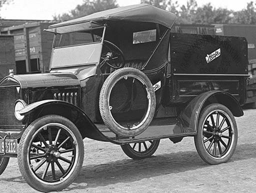 Black and white image of one of the original Hertz Ford Model-Ts parked on dirt road.