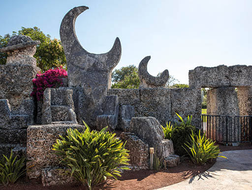 A view of one of the borders of Coral Castle in Homestead, Florida, on an early evening in spring.