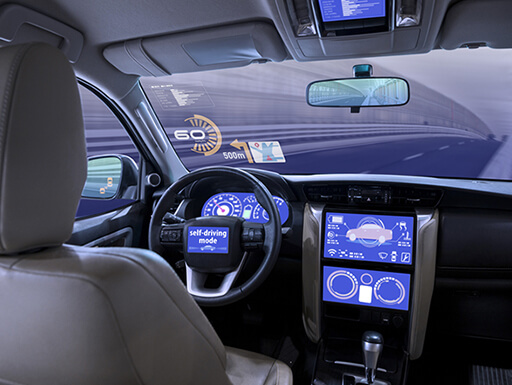 Inside view of empty car equipped with back-lit heads-up display.