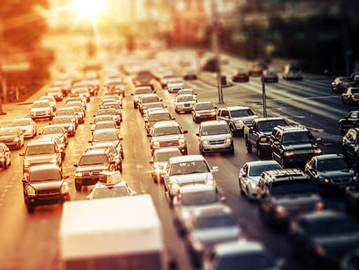An aerial view of a traffic jam during rush hour at sunset