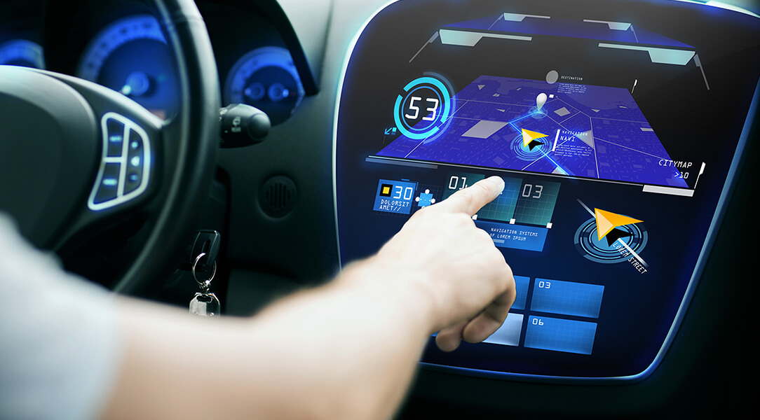 A driver programs his vehicle with an in-dash touch screen navigation system