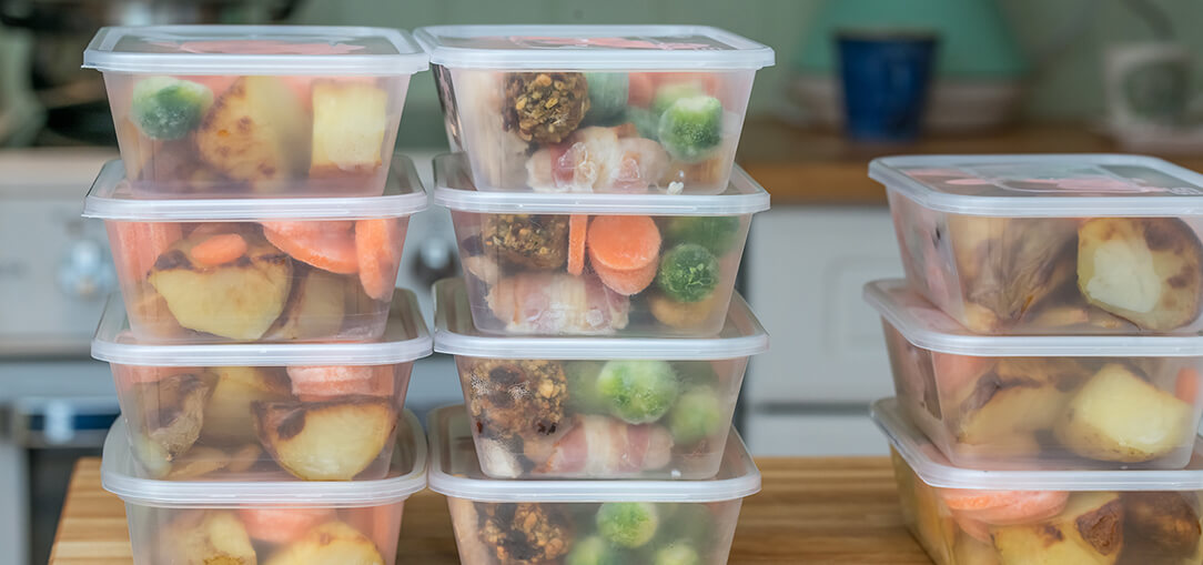 Stacks of Tupperware filled with home-cooked meals, made while meal prepping for the work week.