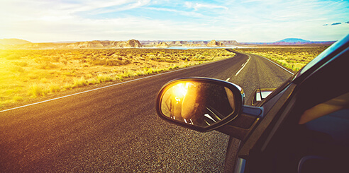 Car driving along winding road on a sunny day in Arizona