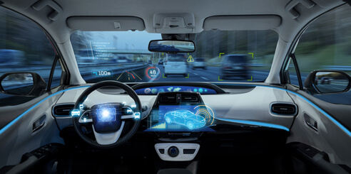 An interior view of a self-driving vehicle with heads up display and advanced digital graphic of the vehicle's exterior