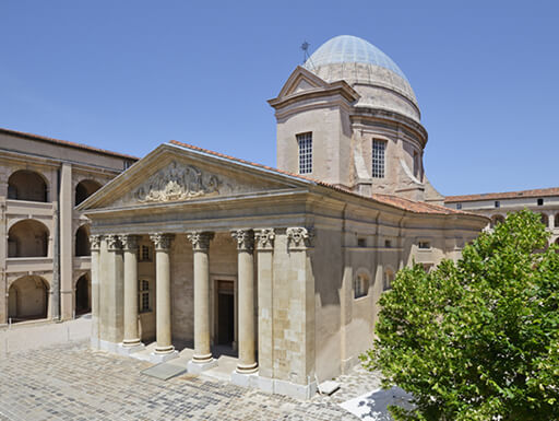 A view of the historic Vieille Charite temple in Marseille, France on a clear afternoon.