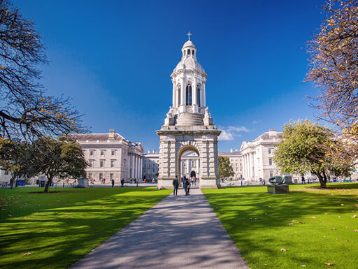 A gorgeous sunny day at Trinity College Dublin shows the beautiful architecture and courtyard of the college in Dublin, Ireland.