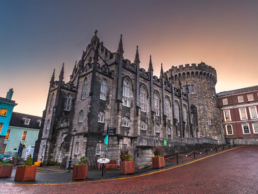 ALT= An impressive view of the medieval Dublin Castle in the Old City of Dublin, Ireland at dusk.