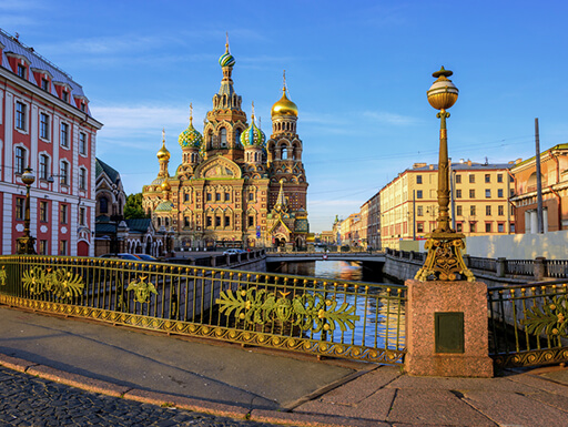 Church of the Savior on Spilled Blood and the Griboyedov Canal are seen on a clear, golden afternoon in St. Petersburg, Russia.